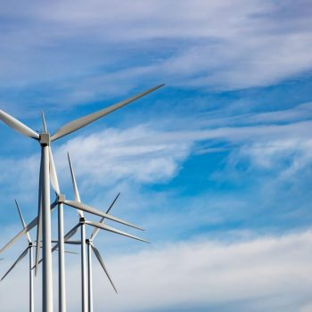 wind-turbines-renewable-energy-on-blue-cloudy-sky--PKJDF8J