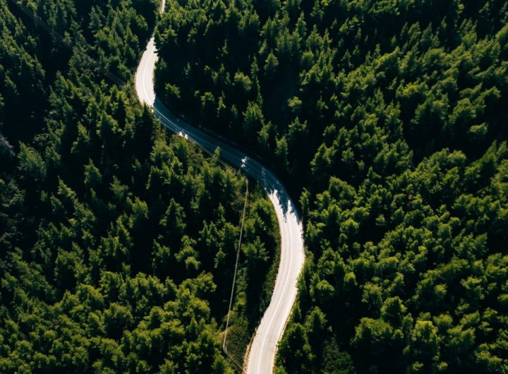aerial-view-of-curve-road-on-the-mountain-with-gre-P5KUQ63