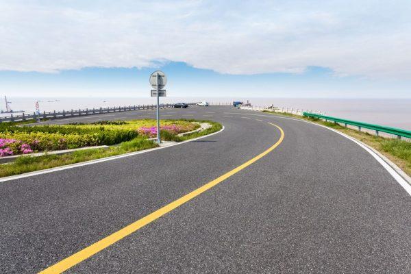 asphalt-road-by-the-sea-P94VJVN