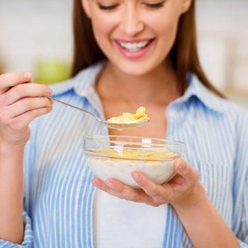 healthy-breakfast-girl-eating-cereals-with-yogurt-G49EF6X