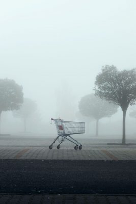 abandoned-shopping-cart-on-parking-lot-in-thick-fo-BKQN8DW