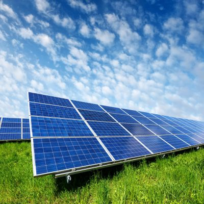 solar-panel-on-blue-sky-background-P97DW43