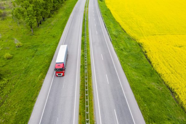 aerial-view-of-a-truck-on-the-highway-at-sunset-s-2021-06-17-00-23-30-utc