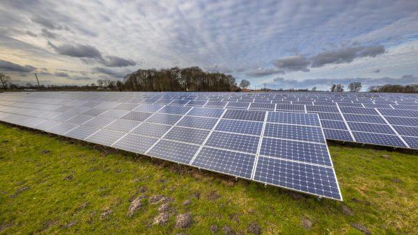 solar-energy-panels-clean-energy-background-WKY4FJ5