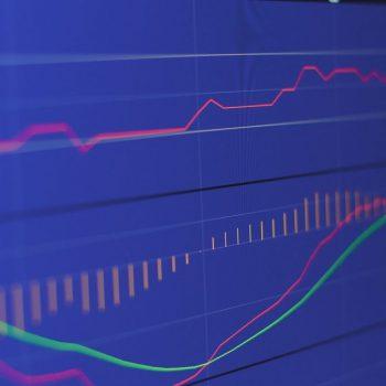 stock-market-chart-on-blue-background-V9A3YKT
