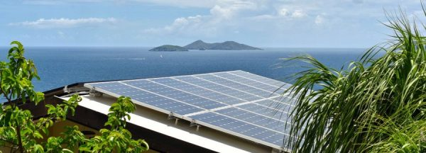 tropical-solar-energy-rooftop-panels-in-a-caribbea-JBZ2V4T