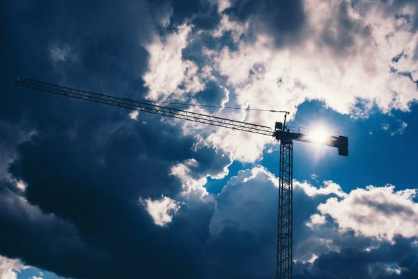 silhouette-of-industrial-construction-crane-with-d-2021-08-26-15-28-00-utc